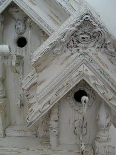 Bird house built from salvaged picture frames, candle stick columns, vintage iron curtain rod corbels and hooks used for their perches #birdhouses