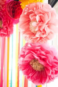 paperf flower backdrop - photo by Ely Fair Photography http://ruffledblog.com/colorful-fiesta-wedding