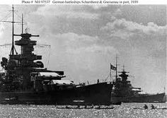 Battleships Scharnhorst (foreground) and Gneisenau,1939: the latter has already been modified with raked 'Atlantic' bow and funnel cap, whereas Scharnhorst has not.  When this work took place shortly afterwards her main mast was moved further aft than Gneisenau's, making it easy thereafter to tell them apart.