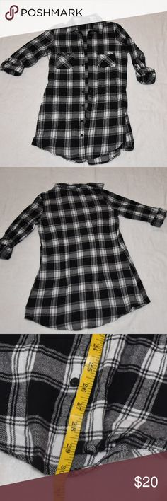 "Women's  Long Flannel Shirt Darling black/white plaid flannel shirt.  30"" from collar to bottom of shirt.  Long enough to wear as a dress for us short gals (I'm 5'1).  I've also worn it tied in the front with crop tank top underneath.  Styling possibilities are endless.   Super cute!  Great used conditon. Charlie Paige Tops"
