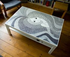 IKEA Hacker art....taking a Lack white coffee table and adding your own black marker art.