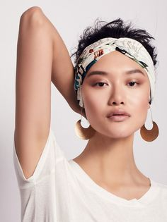 Cha Cha Headband   Printed cotton headband featuring a retro-inspired knotted detail.      * Stretchy elastic band at the back for an easy fit