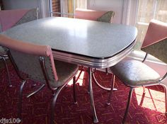 "Nice ""cracked ice"" pattern Formica table with four pink and grey dinette chairs. I want this!"