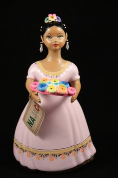 - Quinceañera, Mexican Ceramic Figurine with a Rose colored dress. - A Quinceañera is a celebration of a girl's fifteenth birthday in Mexico and elsewhere in communities of people from Latin America.