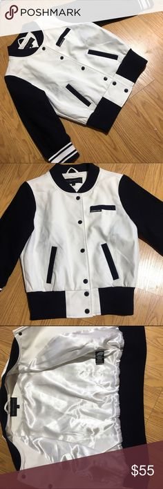 "NEW MEMBERS ONLY cropped sleeve varsity jacket NWOT. White faux leather with wool sleeves. Button down with front pockets. Members only logo on front. Sleeves are 18"" and shoulder to bottom hem is 20"". members only Jackets & Coats"