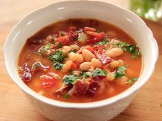 Bean with Bacon Soup | Ree Drummond  Soak the northern white beans overnight and it'll take <2 hrs to cook up some delicious comforting soup