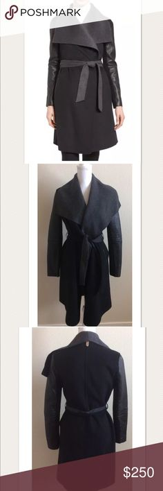 """$795 Mackage Leather Sleeve Wool Blend Wrap Coat Retails for $795 + Tax- SOLD OUT  Lambskin leather sleeves (paneled with stretchy ribbing for flexibility)  True-wrap style Oversized wing collar Removable reversible belt 70% wool, 30% polyester; leather and 53% acrylic, 23% wool, 19% polyester, 5% spandex   Measures approximately: total length 37""""  **Has an open/split seam on the back of the shoulders- along the seam. Easy to sew/repair. Gently worn. Needs a light roll over with a lint…"""