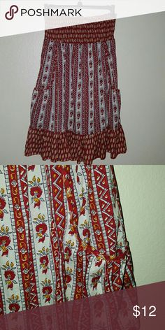 """B1G2 Free Vibrant Sundress Adorable sundress in a fun vibrant pattern. Side pockets. Ruffled at the hem. Measures 14"""" across at chest lying flat (has lots of stretch). Measures 28"""" from top to bottom. One size. Dresses Strapless"""