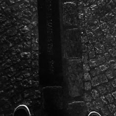 A shot of me standing with my feet on both the east and west sides of what used to be the Berlin Wall.