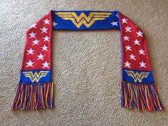 Wonder Woman double knit scarf -- red and blue backgrounds are reversed on each . Wonder Woman double knit scarf -- red and blue backgrounds are reversed on each side while stars and WW motif are the sa. Knit Or Crochet, Crochet Scarves, Crochet For Kids, Crochet Hats, Crochet Granny, Hand Crochet, Double Knitting Patterns, Crochet Patterns, Scarf Patterns