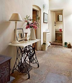 table base is from an antique sewing machine, old stone floor