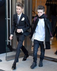 Trendy kids: Model Romeo cut a suave figure in tailoired suit, while young Cruz opted for ...