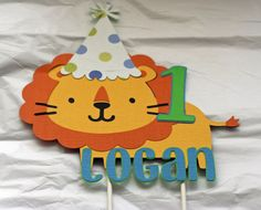 Jungle Safari Zoo Lion Cake Topper with Party Hat. $10.50, via Etsy.