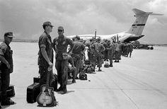 Some of the 300 troops of the 9th Infantry Division scheduled for departure from South Vietnam line up to board aircraft bound for Hawaii, August 27, 1969....