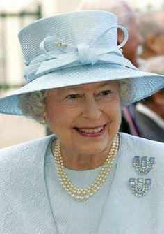 HRH Queen Elizabeth II wearing her 18th Birthday Aquamarine Clips - an eighteenth birthday present from her parents King George VI and Queen Elizabeth in 1944.