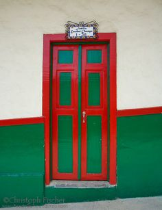 A typical brightly painted front door of a house in Salento, Quindio, Colombia Big Doors, Windows And Doors, When One Door Closes, Antique House, House Front Door, Unique Doors, Painted Doors, Home Signs, Exterior Doors