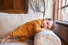 Katrina Tang Photography for Oeuf NYC BABiES AW 15. Baby boy leaning on couch, yellow babywear, happy baby #katrinatang #tangkatrina