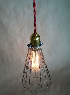 Rustic, conical, wire sculpture light for hanging or standing. on Etsy, $97.50