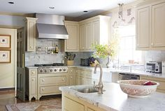 Will be painting our oak cabinets not white but a lighter color like this