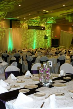 Silver table cloth and chairs, black runner maybe... :  wedding purple reception decor