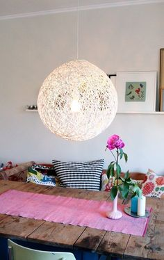 When we first saw the Whirl-It Lampshade, we immediately imagined it hanging over our dining room table. It's like something you'd see priced for quite a lot of money in a design shop, and yet this version is homemade. And it's really quite simple to make: you basically just need a balloon, cotton yarn, and wallpaper glue.