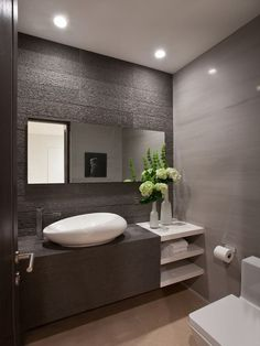 Bathroom Design, White Contemporary Powder Room Sinks With Unique Shape Design And Modern Faucet And Modern Bathroom Vanity Design And White Wonderful Vase With Beauty Flowers On It Also Minimalist Wall Design And Toilet: Powder Room Decorating Ideas at Your Home