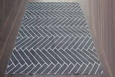 Herringbone Tile, Herringbone Tiles Bathroom, Bathroom Wall Tile Design | HERRINGBONE OUTDOOR RUG | £92 | Meem Rugs on Treniq Wall Tile, Bathroom Wall, Luxurious Bathrooms, Herringbone Tile, Rug Company, Commercial Furniture, Hand Tufted Rugs, Eclectic Style, Tile Design