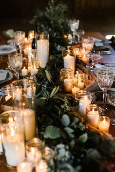 Romantic wedding centerpiece - greenery garland with votive candles {Lindsey M. Events}