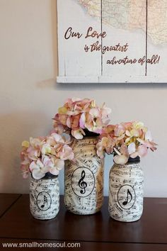 Easy DIY Sheet Music Mason Jar Vases - Girl, Just DIY! : These lovely sheet music mason jar vases are perfect for any room in your house. They are an easy craft and perfect for homemade gift ideas. Mason Jar Vases, Mason Jar Lighting, Mason Jar Diy, Mason Jar Projects, Mason Jar Crafts, Diy Home Decor Projects, Diy Projects To Try, Craft Projects, Creative Crafts