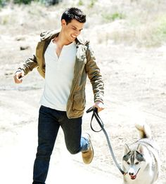 Taylor Lautner & a husky...that's all I would need in life..except that's not his dog...he really has a maltese! lol
