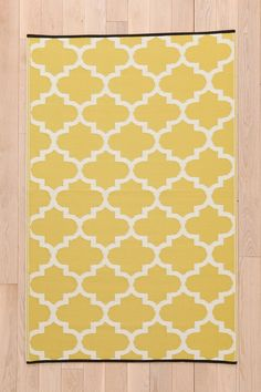 Indoor/Outdoor Tile Mat. Love this color, could def match chairs for balcony...too much yellow though?