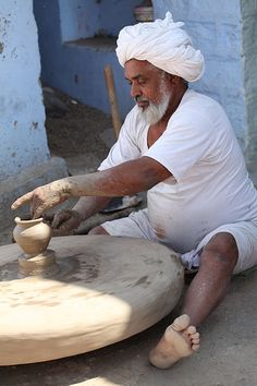 Spinning a pottery wheel