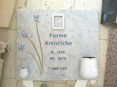 Loculo realizzato dalla Fornasa Marmi snc con incisione e applicazioni bronzo dipinto
