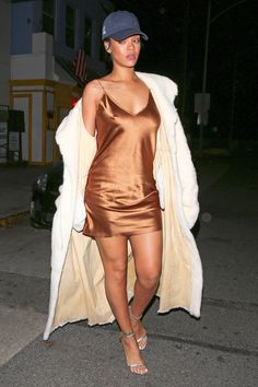 Always the fashion maverick, a leggy-looking RiRi stepped out for dinner last night in Santa Monica wearing an unexpected curation of pieces. A silky metallic slip dress and a faux fur coat with strappy Tom Ford sandals and a baseball cap—why not? It somehow comes together in a perfectly undone, sexy-without-trying way that only Rihanna could pull off.    - MarieClaire.com