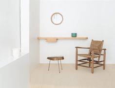 Mirror by Frida Audoux Minet - Wall mounted shelf by Charlotte Perriand - Side table by Carl Aubock  - Arm chair by Charlotte Perriand     Photography by Kiwibravo