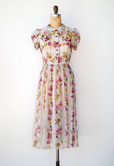Sweetly lovely vintage sheer bright floral dress with puff sleeves.