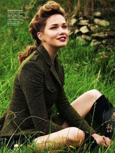 Green tweed jacket and hairstyle
