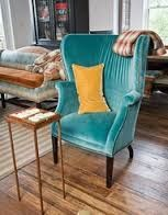 vintage wing chair that can be reupholstered in cool fabric..