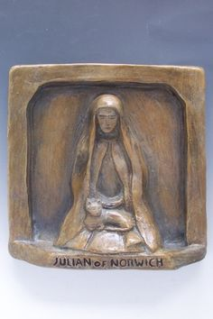 Julian of Norwich, Patron of Cats  Julian, born in England in 1342, was an anchoress in the medieval city of Norwich. A medieval anchoress like Julian lived in a cell built into the wall of a church. Julian's function was to pray, to be still, and to give counsel to any who sought her advice. Many medieval anchoresses kept cats as mousers, and a longstanding legend has it that Julian too had a cat in her cell: a stained-glass church window in Norwich shows Julian with her cat.