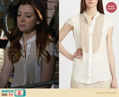 Lily's white and nude front panel blouse on How I Met Your Mother. Outfit Details: http://wornontv.net/28384 #HIMYM #fashion