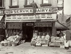 May 1, 1937, New York. Grocery at 1028 Third Avenue and 61st Street with Salvatore Campanelli far right.
