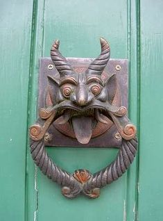 Door knockers can be found on front doors all over Europe. When you walk up to a front door and see one, don't you just have to use it? Anyone out there have a knocker on their front door?