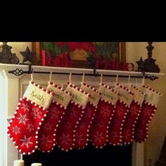 2 stocking hooks holding a curtain rod to hang stockings- genius!
