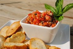 Bruschetta - i love this stuff!!! I don't like the bread to crispy though  (4-5 roma tomatoes or 3-4 regular tomatoes) diced small 1 clove garlic minced  1/4 cup fresh basil chopped fine  2 Tbs Olive oil 1 Tbs red wine vinegar ½tsp each salt & pepper (or to taste) mix all ingredients and let stand for 2 hours. ---1 baguette (brush on slices olive oil & fresh garlic for toasting) toast in oven until golden brown on 350 for just a few minutes. cool bread completely and serve.