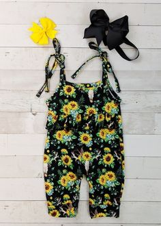 Sunflower and cow skull print romper with tie straps. Any accessories shown are not included. Toddler Boutique Clothing, Wholesale Children's Boutique Clothing, Girls Boutique, Cut Out Leggings, Denim Overall Dress, Cute Girl Outfits, Toddler Dress, Cute Girls, Cow Skull