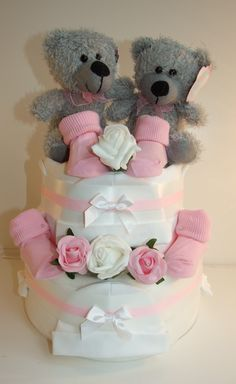 This is a custom design twins nappy cake I made to order. Please contact me if you would like me to make a custom design for you.