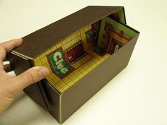 I like the surprise of the board game design on the inside of these upcycled board game boxes.