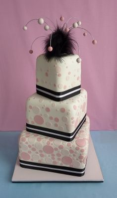 Modern #wedding #cake in pastel pink and cream color with black accent stripe and poofy thing on top. ~ trish #weddingcake #mod