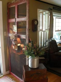 Love the old screen door room divider.perfect for entryway, table on door side.