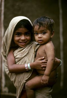 I want to visit India, but I'm afraid I would come home with more kids - Children in Hyderabad, India.   United Nations Photo/John Isaac.
